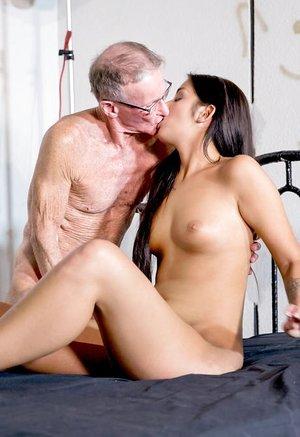 Teen black-haired Loren is so horny she fucks and sucks two oldman cocks