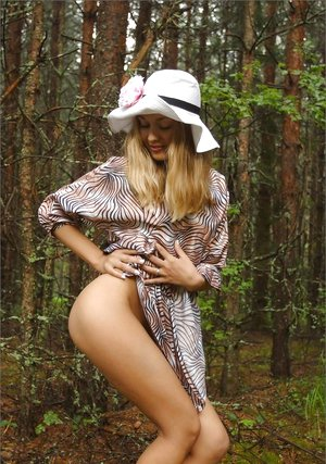 Cute blonde Sweet Lilya lifts dress for sexy upskirt in the woods & romps nude
