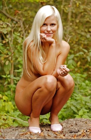 Skinny pure tenderness Dido A with blonde hair and lil' pussy poses outdoors