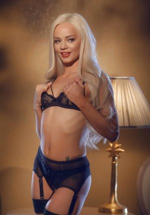 Beautiful solo chick Elsa Jean licks her red lips while playing with her pussy