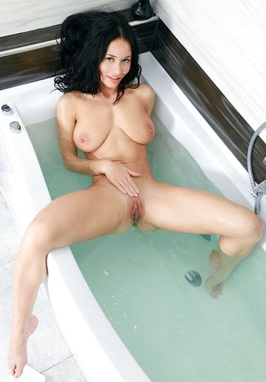Teenage stunner Mila M shedding swimsuit in shower to flaunt nice ass