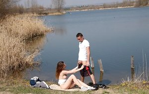 Insatiable teen girl sucks the jizz from her guy's cock after lovemaking by the water