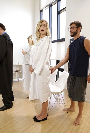Blond female Haley Reed pounds her stepbrother in the middle of choir practice