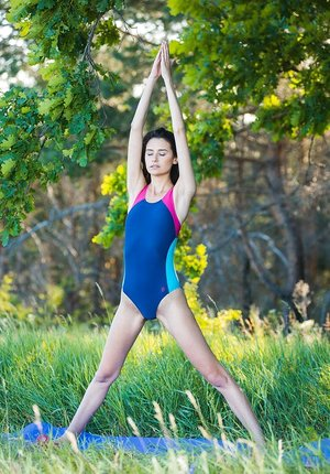 Athletic brown-haired Cristin M models naked after outdoor yoga session