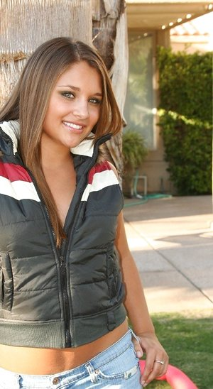 Handsome brown-haired Lili Jensen gets braless outdoors to taunt in jeans